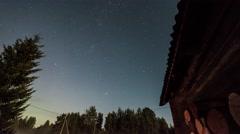 Night lapse. Starry night at village Stock Footage
