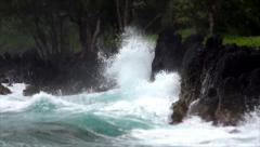 Waves Break on Lava Rock Covered Shoreline in Keanae, Hawaii Stock Footage