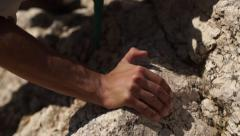 climber advances on the rocks - stock footage