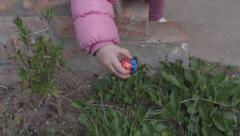 Little baby found easter egg in garden Stock Footage