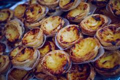 Dark Portugese custard tarts Stock Photos