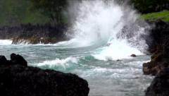 Waves Break Against Lava Rocks in Keanae, Hawaii - stock footage