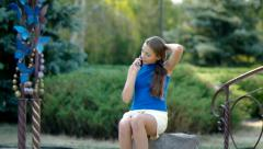 Teenager girl with long hair, talking on the phone. - stock footage