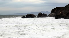 Moderate Wide Shot Of Waves Hitting Headland Rocks - stock footage