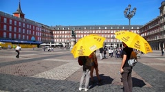 Tourist guides at at Plaza Mayor waiting for the people group in Madrid, Spain - stock footage