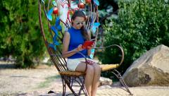 girl - teenager opens e-book reading. - stock footage