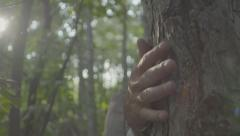 Misterious hand grabs a tree then disappears in slow motion 100 fps Stock Footage