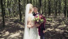 Groom looking at his bride while a forest walk slow motion Stock Footage