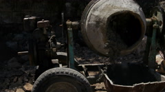Pouring concrete mix from cement mixer. - stock footage