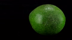 Avocado rotating with black background Stock Footage