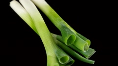 Scallions rotating with black background Stock Footage