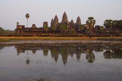 Sunset,  gopura towers of Angkor Wat - stock photo