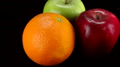 Orange, red and green apple rotating Stock Footage