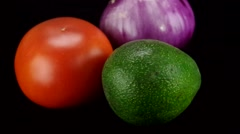 Tomato, onion and avocado rotating Stock Footage