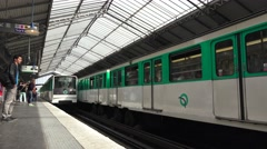 A Paris Metro train (in 4k) pulling in to a station. Stock Footage