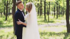 Groom lays his arm on brides waist gently slow motion Stock Footage