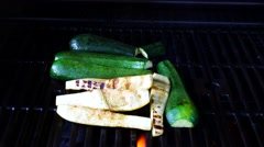 Grilling vegetables on the BBQ. Zucchini and squash filmed in 4K UHD. Stock Footage