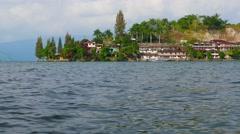 Lake Toba view of Tuk Tuk village. 4K resolution Stock Footage