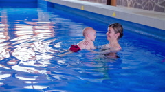 Baby teach swimming Stock Footage