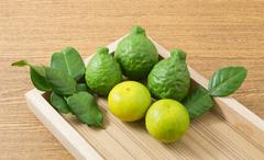 Vegetable and Herb, Fresh Kaffir Lime with Persian Lime and Kaffir Leaves for Stock Photos