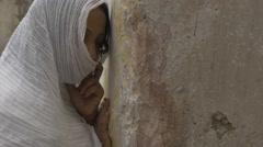 JERUSALEM, ISRAEL - April 10, 2015: Persecuted arabian christian girl praying Stock Footage