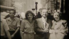 2461 - travelers pause for a photo on busy city sidewalk-vintage film home movie - stock footage