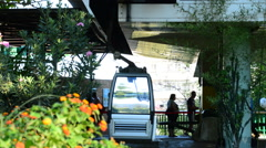 Passengers in a station cable car in Benalmadena town Stock Footage