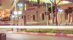 Street-level tracking time lapse of a busy street at night. Cropped. Stock Footage
