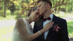 Bride laying her head on grooms shoulder Stock Footage