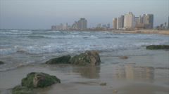 Tel Aviv skyline shore behind waves smashing in from the Mediterranean Sea Stock Footage