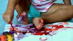 Baby first draws colored oil paints Stock Footage