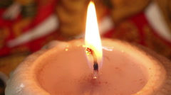 ECU / Closer Close up of Burning Candle against Exotic Background (Static) Stock Footage