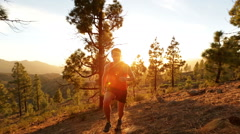 Running Determined Man Jogging On Hill In Forest - STEADICAM Stock Footage