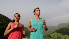 Couple Running Together Against Rainbow Stock Footage