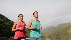 Couple Running Together Jogging Against Mountains - STEADICAM Stock Footage