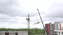 Disassemble crane in construction site. 4K Stock Footage