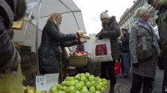 People pay for apple fruits in market to vendor woman Stock Footage