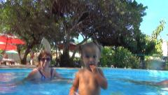 Baby throws a yellow ball in the camera,spray flying into the camera.Slow motion Stock Footage