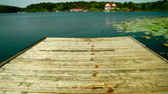 Shabby Wooden Pier With Traces Of Wet Feet Stock Footage