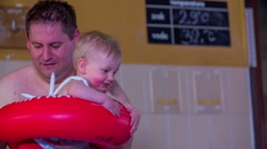 Giving a child for the first time in water Stock Footage