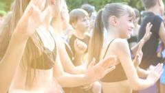 Teen girl dance troupe dancing at a fest on public place Stock Footage