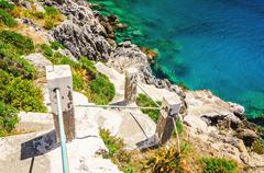 Green bushes and stairs to the beach, Greece Stock Photos