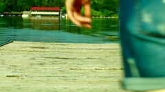 Girl In Shorts Walking On The Wooden Pier Stock Footage