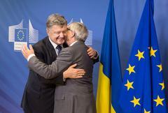 Stock Photo of Jean-Claude Juncker and Petro Poroshenko