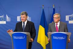 Jean-Claude Juncker and Petro Poroshenko - stock photo