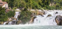 RHEINFALLS, SWITZERLAND - JULY 25, 2015: View to the biggest waterfalls of Eu - stock photo