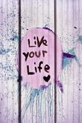 live your life tag style on wall - stock photo
