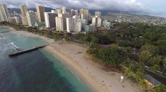 Aerial over Waikiki Beach and hotels and condominiums Stock Footage