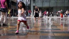 Children playing with fountain on city square Stock Footage