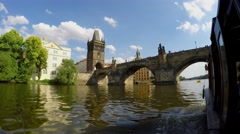 Tourist boat passing under the Charles Bridge (First Person View). Prague Stock Footage